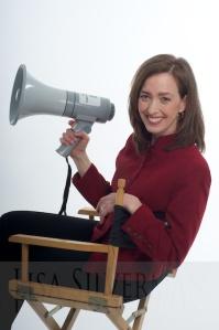 red jacket, chair, megaphone