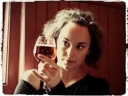 Mirella looking at a glass of beer
